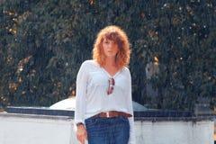Portrait of sad girl summer rain. Portrait of a sad girl summer rain royalty free stock image