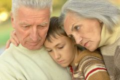 Portrait of sad grandparents with boy Royalty Free Stock Photos