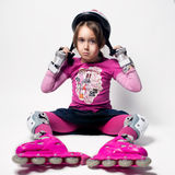Portrait of a sad kid with roller skates Royalty Free Stock Photography