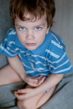 Portrait of sad kid, top view, gray background Royalty Free Stock Photos