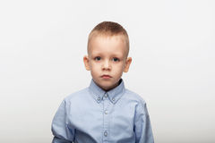 Portrait of a sad little boy in front of white background Royalty Free Stock Images