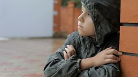 Portrait of sad little boy. Outdoors at the day time. Concept of sorrow stock video footage