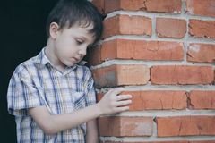 Portrait of sad little boy. Outdoors at the day time. Concept of sorrow stock photos