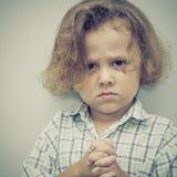 Portrait of sad little boy Stock Images