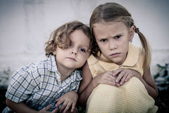 Portrait of sad little girl and boy Royalty Free Stock Images