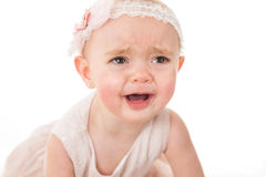 Portrait of sad little girl crying for her toy. Shot against white background Stock Photo