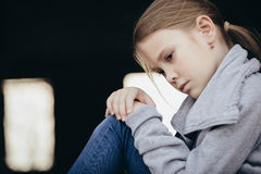 Portrait of sad little girl. Outdoors at the day time. Concept of sorrow stock photography