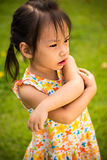 Portrait of sad little girl playing in summer park Royalty Free Stock Images