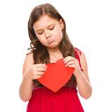 Portrait of a sad little girl in red Stock Photo