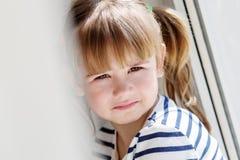 Portrait sad little girl sitting Stock Photo