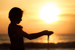 Portrait of sad  little girl standing on the beach Stock Photography