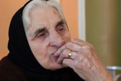 Portrait of sad lonely pensiv grandmother Royalty Free Stock Image