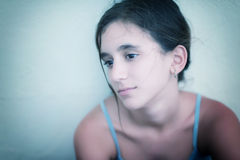 Portrait of a sad and lonely teenage girl stock image
