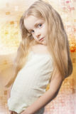 Portrait of sad looking little blond girl Stock Images