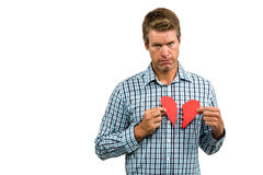 Portrait of sad man holding broken heart Stock Image