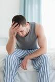 Portrait of a sad man sitting Stock Photo