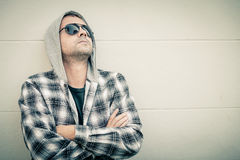 Portrait of a sad man in sunglasses sitting near the house Stock Photography