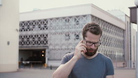 Portrait of sad man walking. Young guy calling to someone. Male using smarphone, wireless technology for talking. stock video footage
