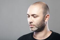 Portrait of sad mature caucasian man isolated on gray Royalty Free Stock Images