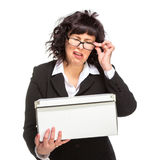 Portrait of sad mature woman with box, wearing glasses, looking at c Stock Images