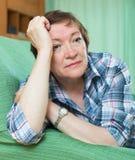 Portrait of sad mature woman Stock Photo