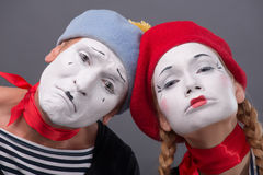 Portrait of sad mime couple crying isolated on Stock Photography
