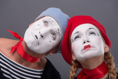 Portrait of sad mime couple crying isolated on Royalty Free Stock Image
