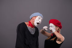 Portrait of sad mime couple crying isolated on Royalty Free Stock Photo