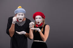 Portrait of sad mime couple crying isolated on Royalty Free Stock Images