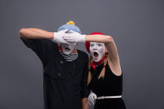 Portrait of sad mime couple crying isolated on Royalty Free Stock Photography
