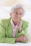 Portrait of a sad old woman Stock Photos