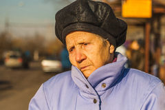 Portrait of sad old woman in the city Stock Photos