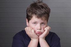 Portrait of sad overweight boy stock photos