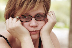 Portrait of sad redheaded woman Stock Images