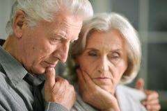 Portrait of a sad senior couple Stock Image