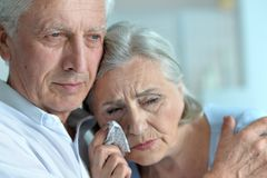 Sad senior couple. Portrait of sad senior couple looking away Stock Photography