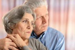 Sad senior couple Stock Photos