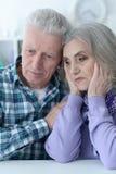 Portrait of a sad senior couple posing stock photo