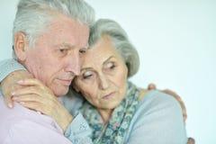 Portrait of a sad senior couple posing royalty free stock image