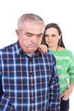 Portrait of sad senior man being comforted by his daughter Royalty Free Stock Photo
