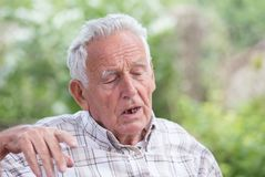 Depressed old man in park Royalty Free Stock Photography