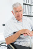 Portrait of a sad senior man sitting in wheelchair Royalty Free Stock Photos