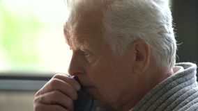 Portrait of sad senior retired man, lonely grandfather, depressed looking, very upset, crying stock video