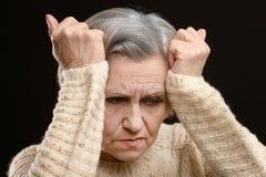 Portrait of sad senior woman Stock Photo