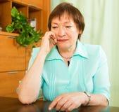 Portrait of sad senior woman Royalty Free Stock Images