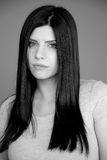 Portrait of sad serious woman with long black hair in studio Royalty Free Stock Photos