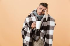 Portrait of a sad sick man wrapped in a blanket stock photos