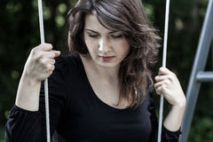 Portrait of sad, swinging woman Stock Images