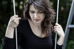 Portrait of sad, swinging woman Stock Images