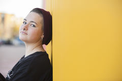 Portrait of a sad teen gay woman on a yellow wall. Portrait of a teen gay woman isolated on a yellow wall Royalty Free Stock Images
